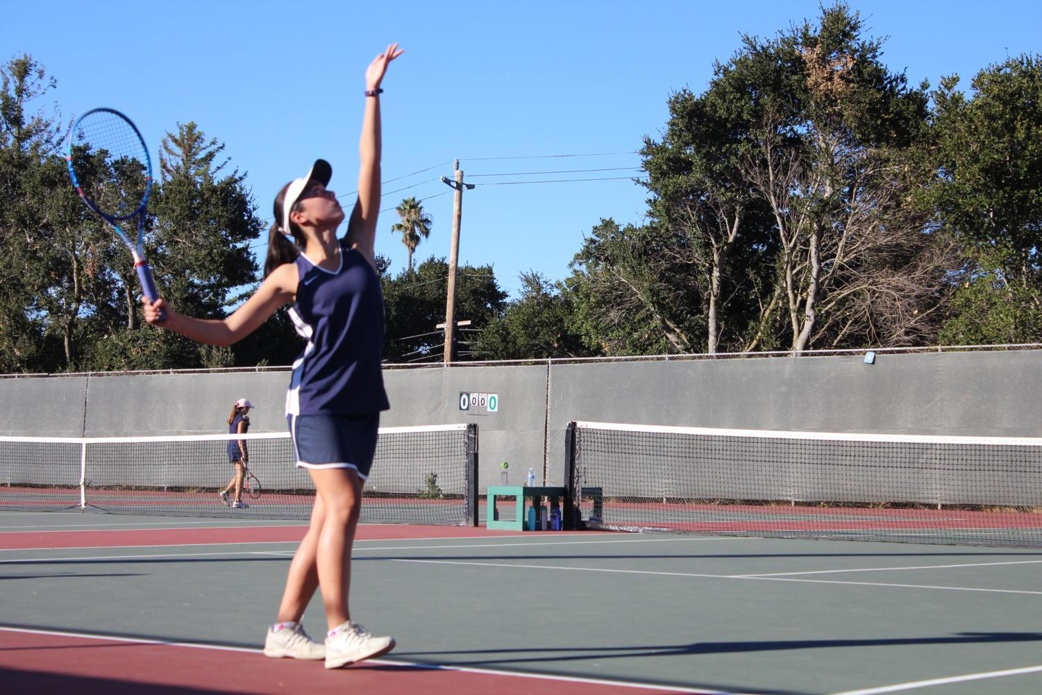 Sophomore+Lily+Gittoes+prepares+to+serve+in+the+first+set+of+her+doubles+match+against+Hillsdale.