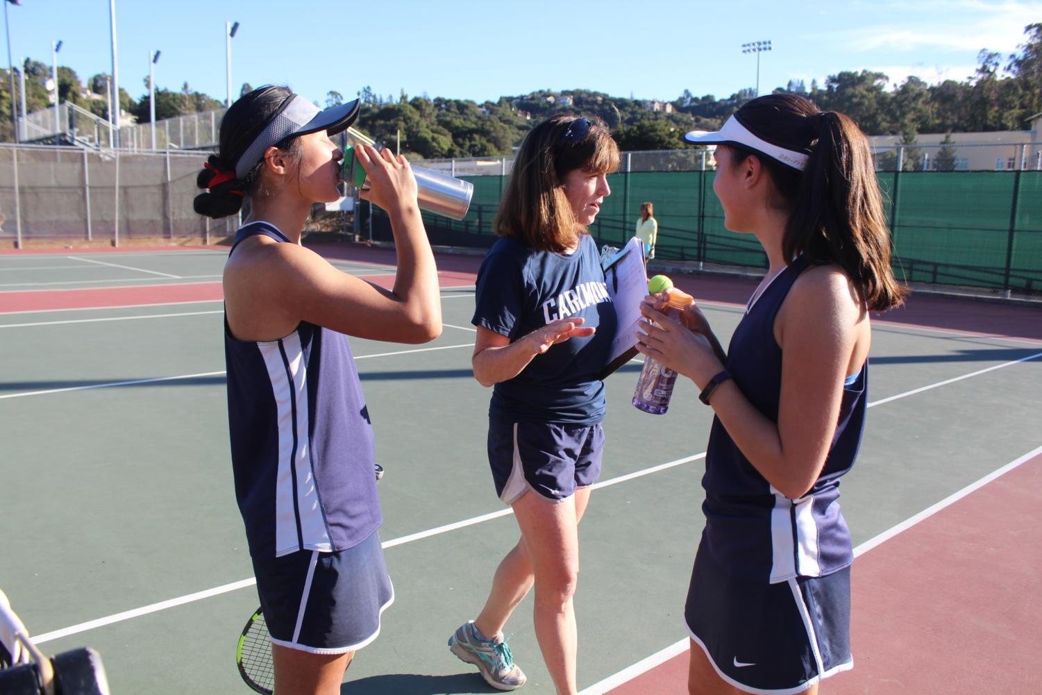 Head+Coach+Margaret+Goldsmith+gives+Nguyen+and+Gittoes+advice+mid-match+on+how+to+improve+their+teamwork.