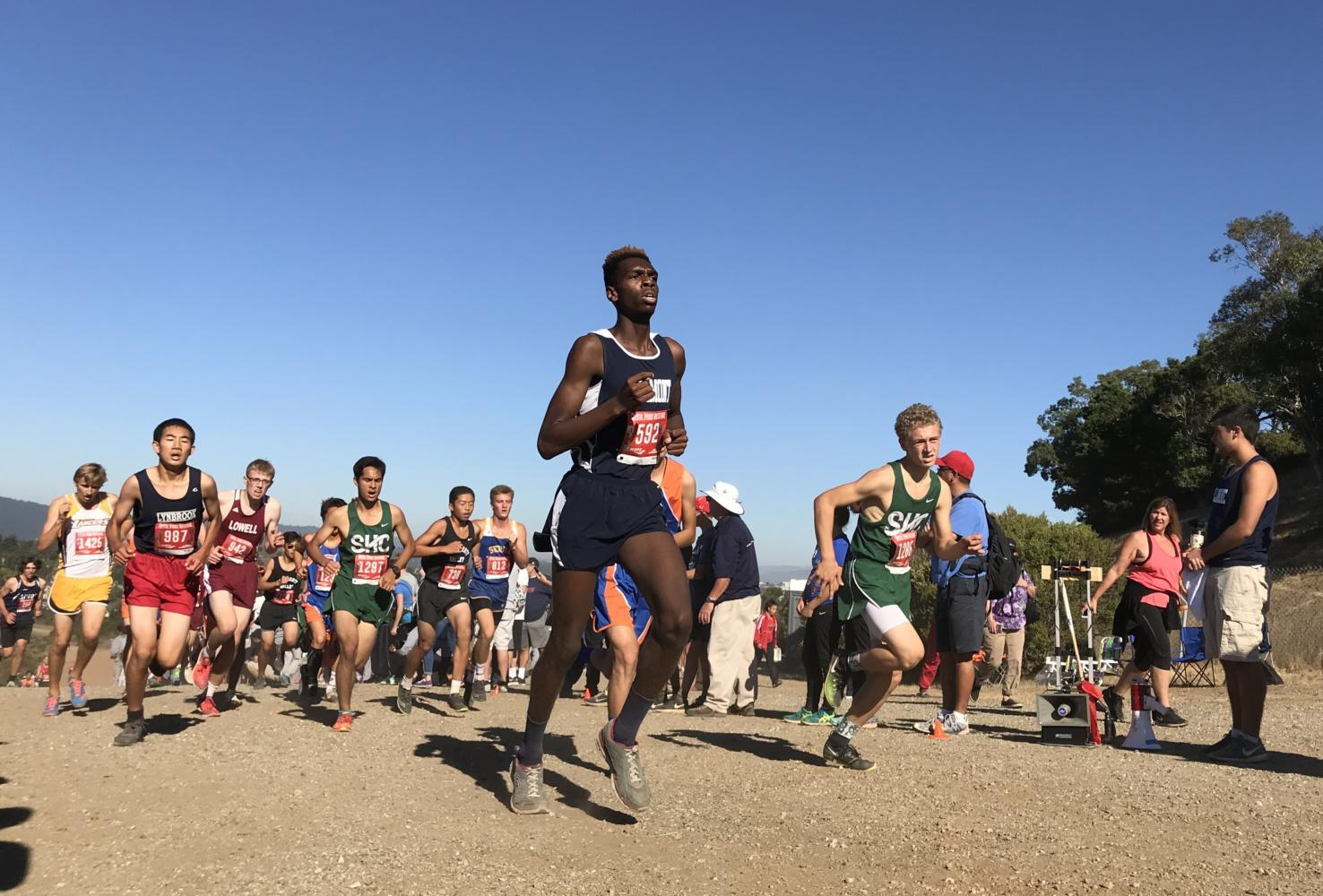 Tanner Anderson, a senior, makes his way up the first major hill of the Crystal Springs Cross Country Course.