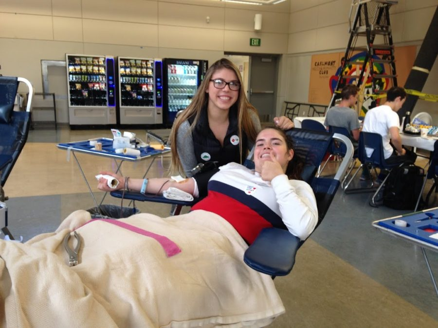 Lizzy+Hall%2C+a+junior%2C+gives+blood+at+the+Blood+Drive.