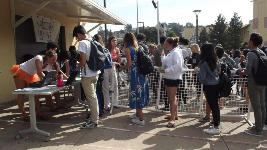 Students+wait+in+line+for+their+homecoming+tickets.+
