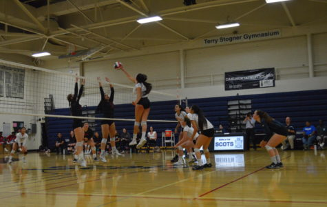 Maya McClellan, a senior, hits the ball over the net as she adds to the number of hits in her overall standings.