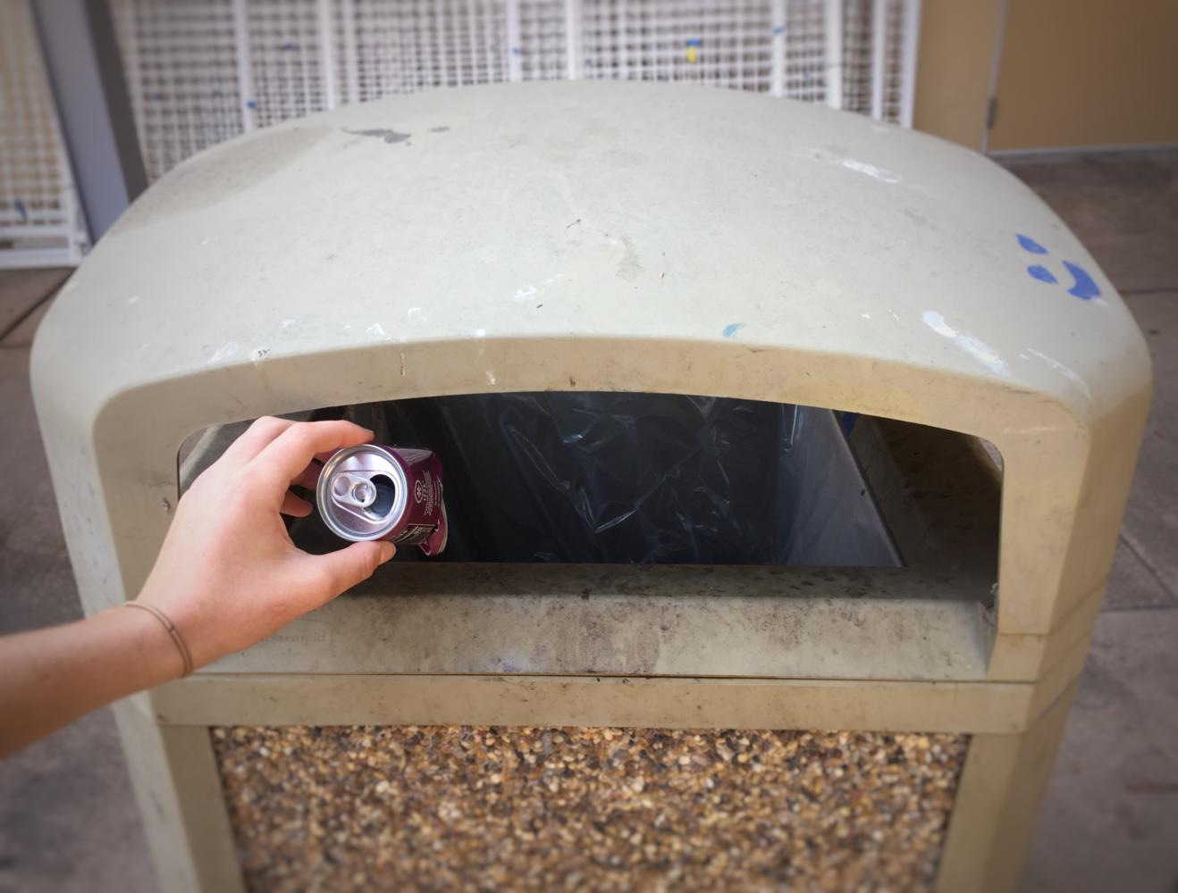 During lunch, Sienna Diehl, a sophomore, throws away her empty soda bottle in the trash can. Soda bottles should be thrown in the recycling bin since they're made of aluminum.
