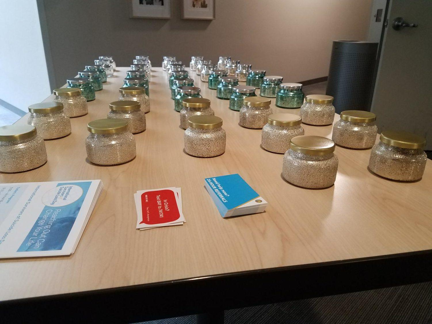 Candles are set out as gifts for survivors to bring home.