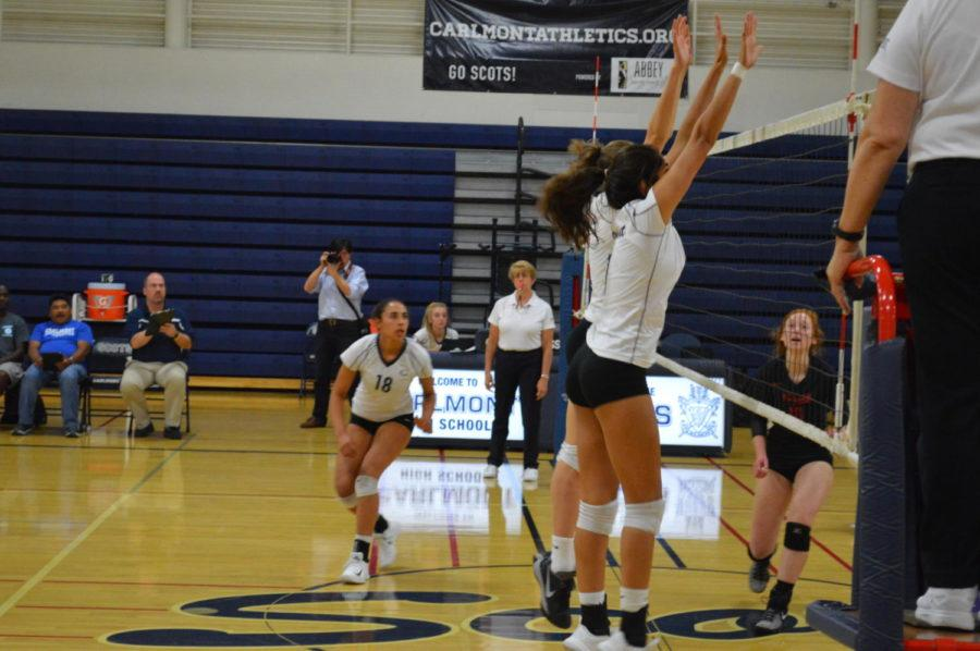 Sophomore Catherine Dahlberg and sophomore Alisha Mitha go up for a block against a hit by the Dons.