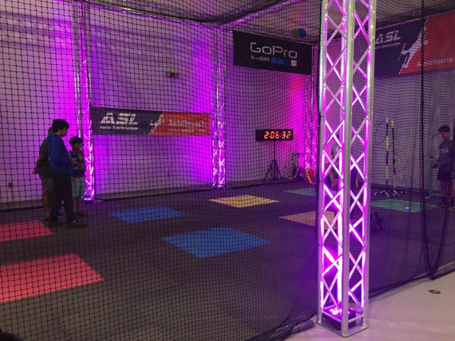 Participants+of+Aerial+Sports+League+workshop+at+Hiller+Aviation+museum+learn+how+to+fly+drones+in+this+glow-in-the-dark+arena.