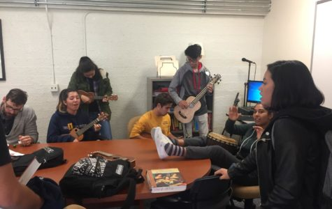 Members of the Ukulele Club perform an impromptu rendition of