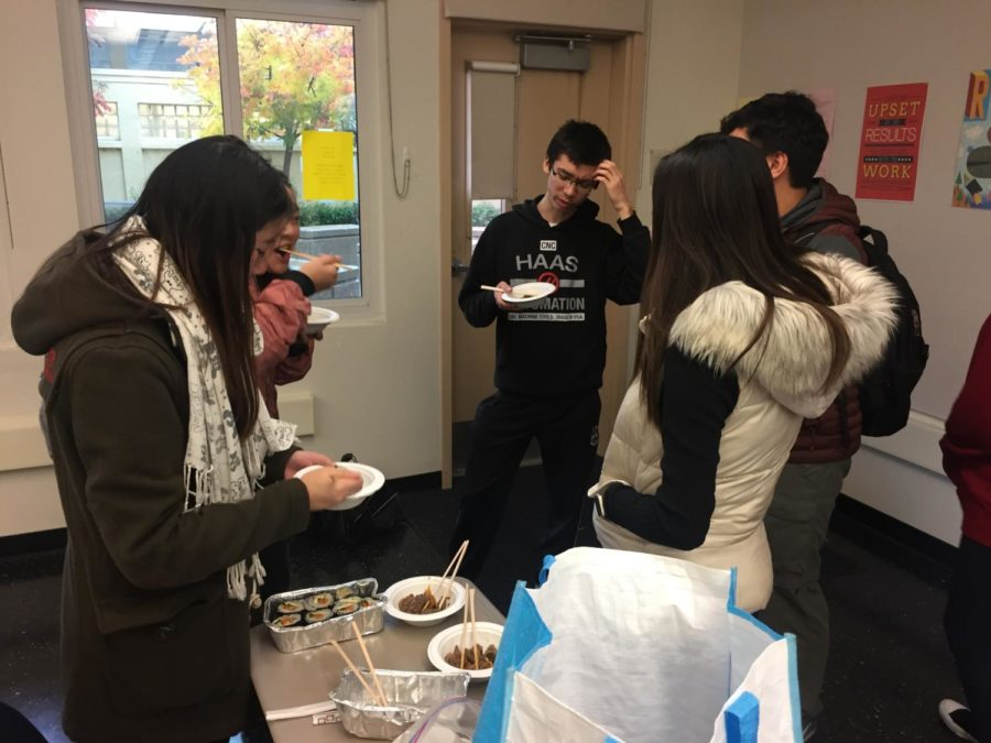Members of Korean Club enjoy kimbap and other culinary delights during a meeting.