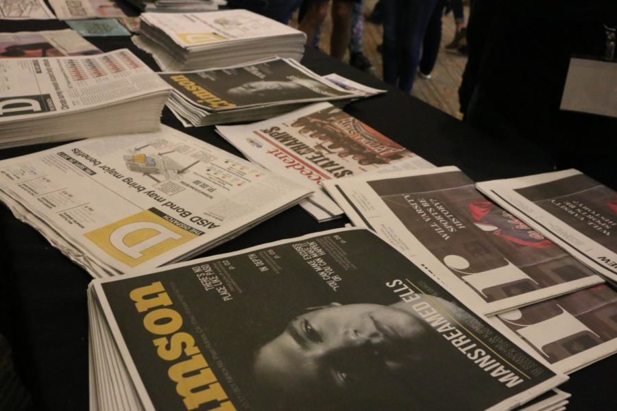 An assortment of High School News Papers is laid out at the National High School Journalism Convention in Dallas. Local publications generally carry a regional bias but are the best sources for describing the impacts of nation-wide events to their native area.