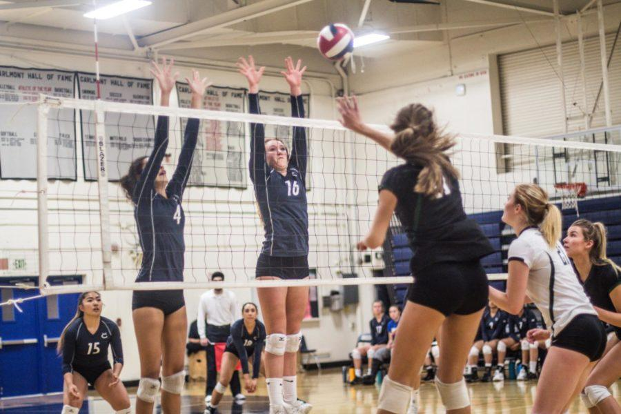 Emma Vanoncini and Sophie Srivastava, both seniors, successfully block a hit from Granite Bay.