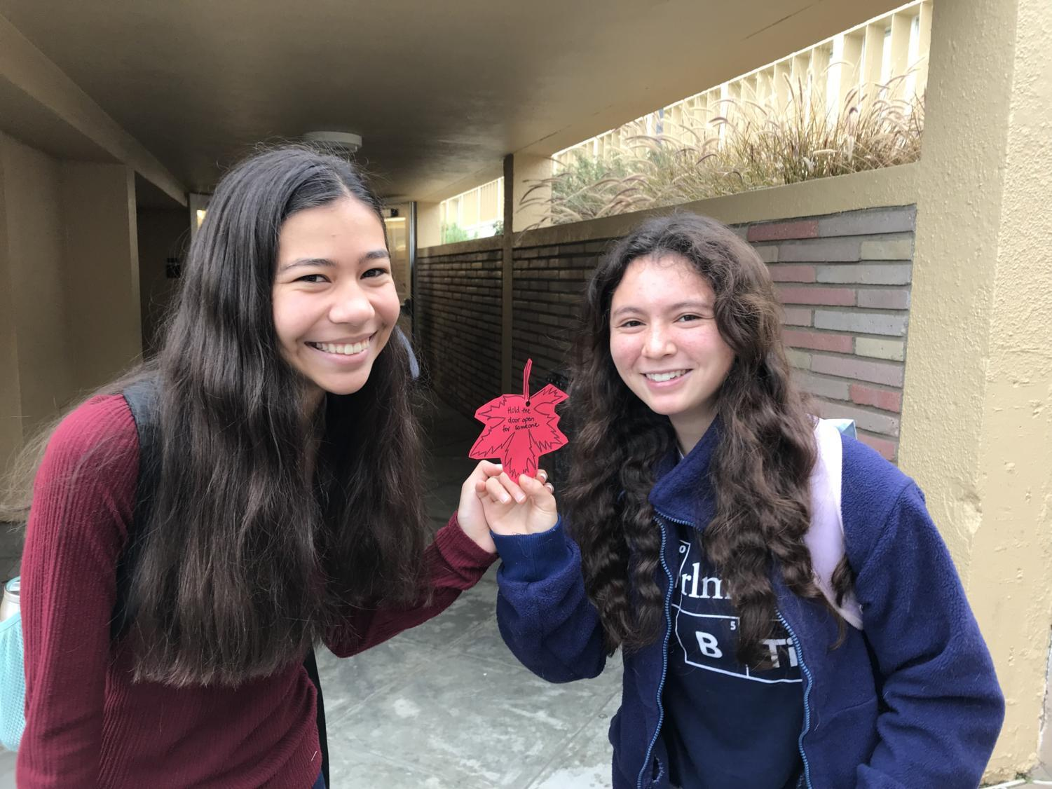 Kayleigh+Bhatt+and+Alyssa+Higdon%2C+both+juniors%2C+participate+in+the+event+by+taking+a+leaf+from+a+nearby+staircase.