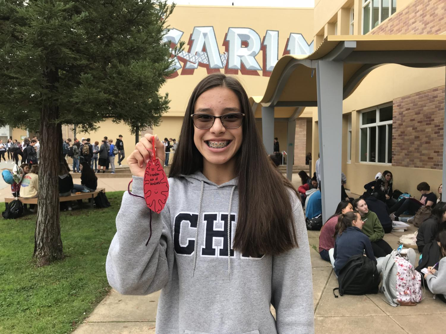 Freshman+Megan+Bhatt+believes+that+the+Thanksgiving+Tree+cultivates+a+positive+environment+for+Carlmont+going+into+the+holidays.+Bhatt+is+thankful+for+%22food%2C+family%2C+and+friends+at+school.%22