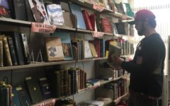 A man shops for a book during the monthly used book sale at the San Carlos  Public Library.