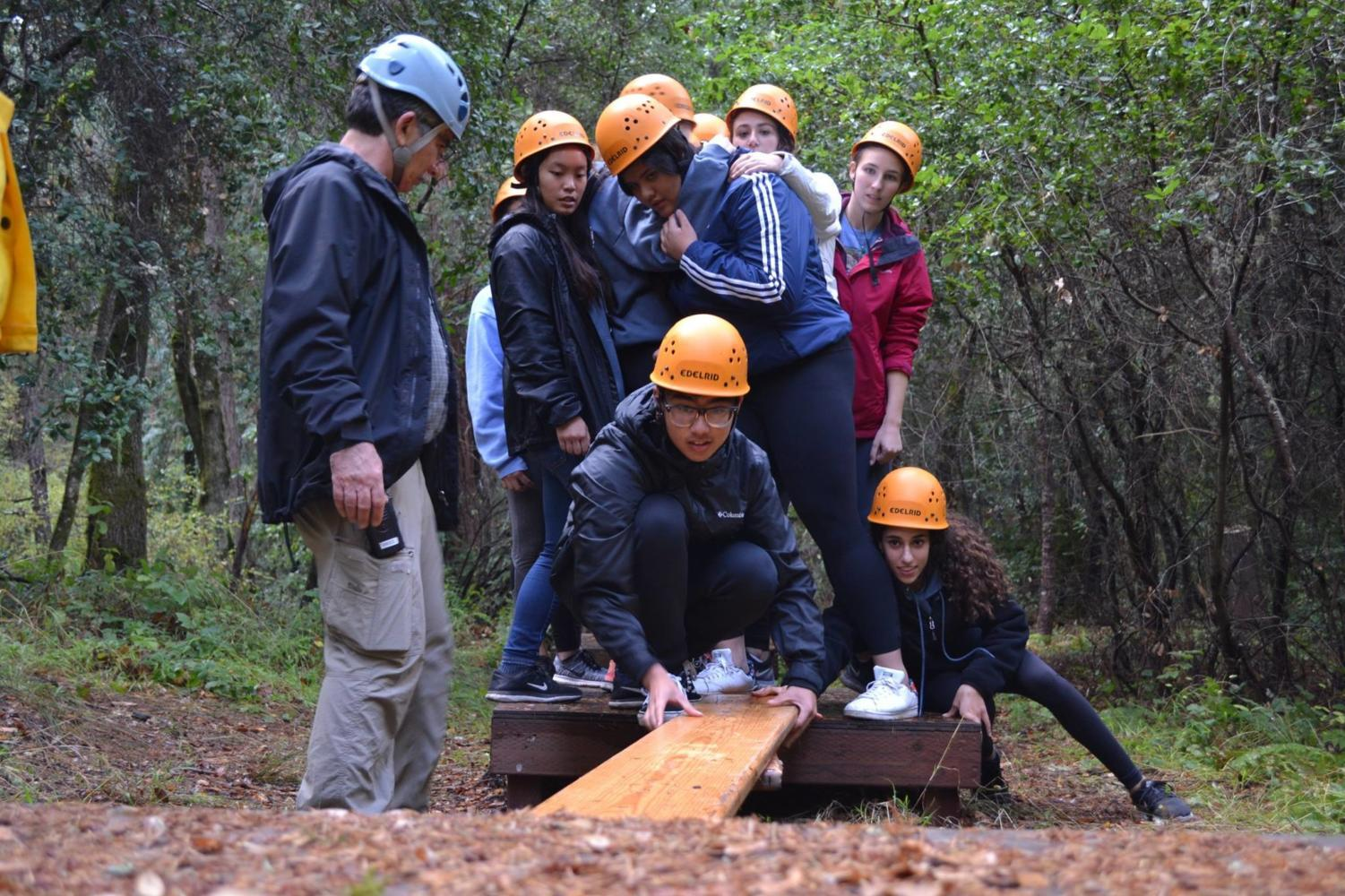The members of ASB's service council work together to complete one of the difficult low courses.