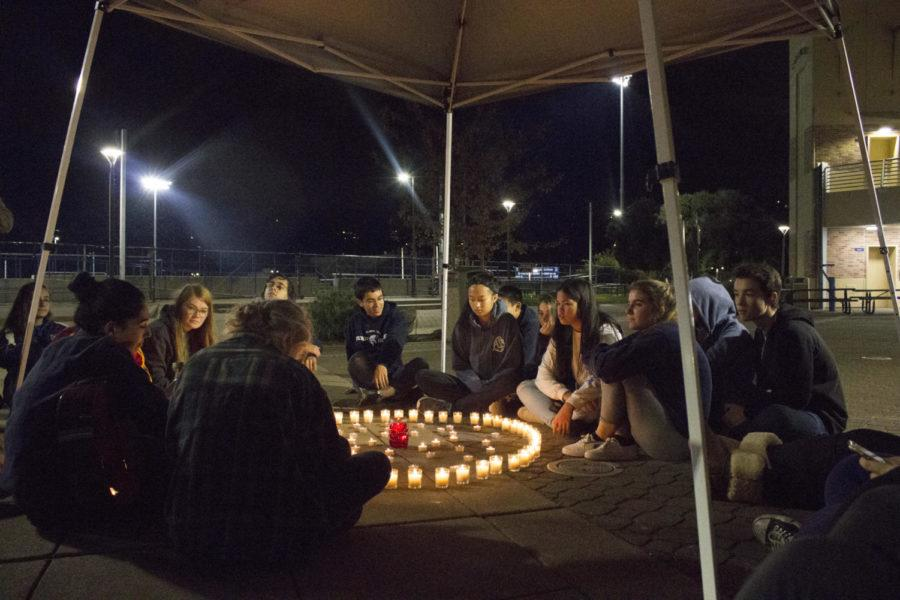 Despite the rainfall, approximately 30 students and staff members sat in the quad to mourn the loss of the victims of recent attacks.