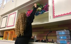 Sophomore Samantha Day organizes the numerous blankets made by the Kozy Kids Club members.