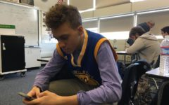 Zachary Kuchlenz, a junior and a Warriors fan, wears his teams colors in math class.