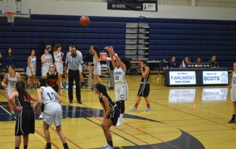 Varsity girls' basketball takes the win against the Gunn Titans