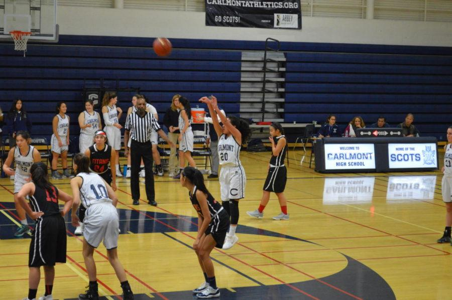 Sophomore+Erica+Mendiola+makes+her+second+free+throw+after+being+fouled+by+one+of+the+Gunn+High+School+Titans.