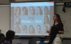 Feminist Club president Isabel Harnett shows TIME's video on The Silence Breakers.