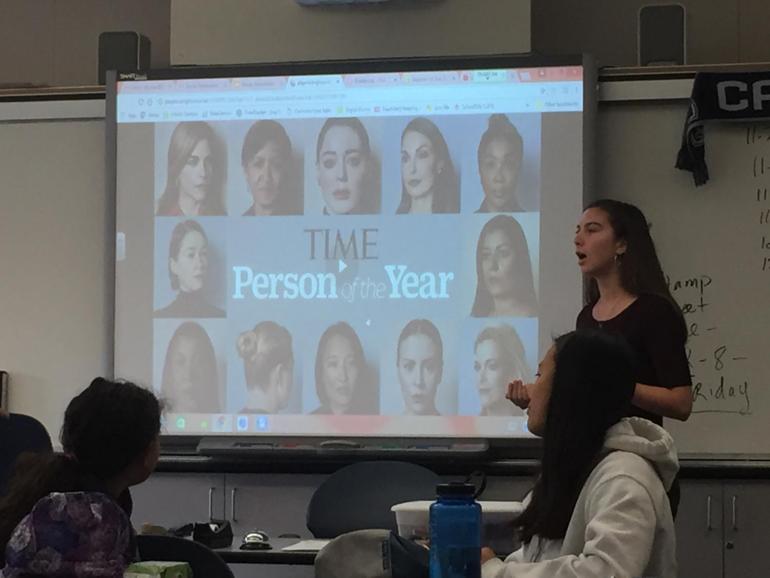 Feminist Club president Isabel Harnett shows TIME's video on The Silence Breakers.