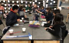 Art Club members work on their art pieces.