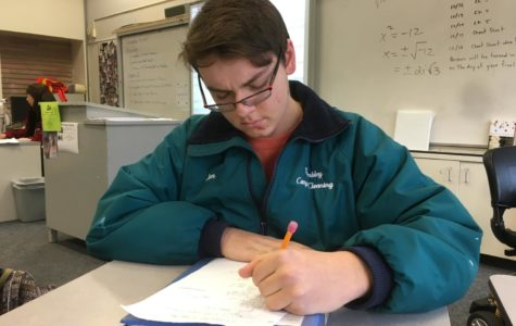 Paul Trembley, a junior, studies for his finals during review week.