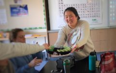 Cindy Chen hands out cookies to her Hope Brigade Club members at one of their regular Thursday lunch meetings in room S20.