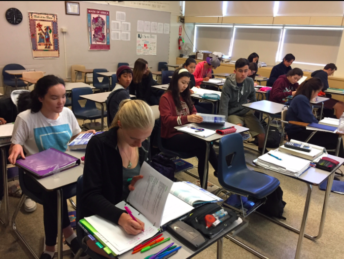 Students take a math contest to receive extra credit.