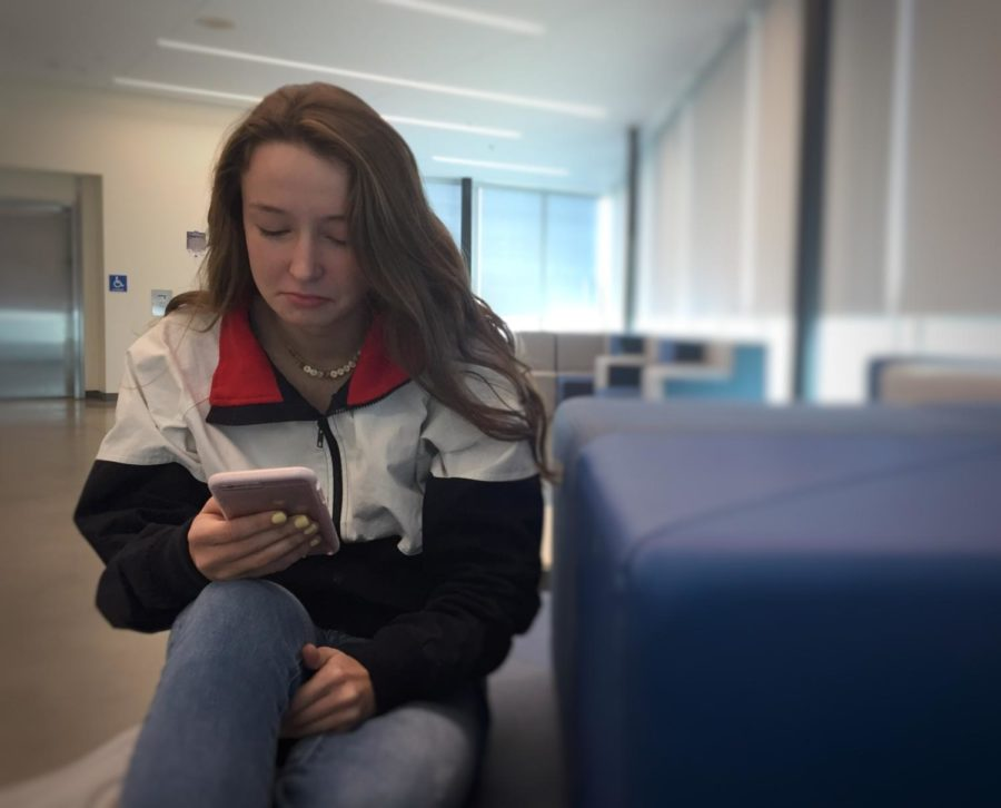 Sophomore Gaby Pierce looks at her phone, confused and upset because she does not know why she was ghosted.