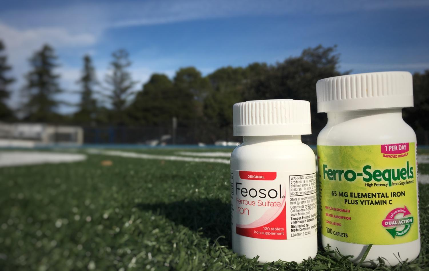 The iron supplements Allie Ayers takes in order to keep her levels of iron stable are positioned on the soccer field at Carlmont High School, where Ayers realized something was keeping her running from improving. She eventually learned that she was severely anemic.