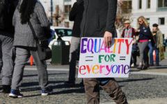 In addition to supporting women's rights, marchers also hold signs for sexuality and identity equality.