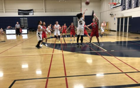 Valerie Kuo goes in for a 3 pointer to keep Carlmont in the lead.