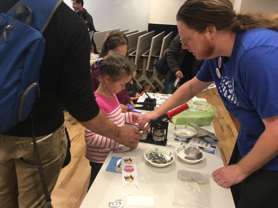 Kids learn how to make buttons at the San Carlos Library's ST.E.A.M. Fair.