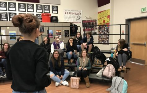 Kiran Boone, a senior and copresident of Choir Council, addresses fellow council members during their meeting in F21.