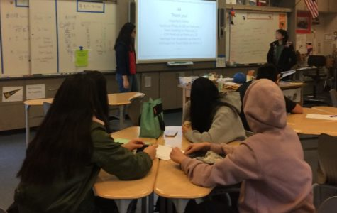 A group of students listen to a presentation in Chinese Culture Club