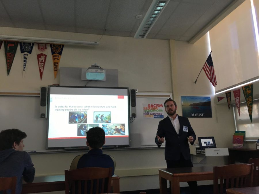 Richie Rasor tells kids about what Tesla is doing to help the environment.