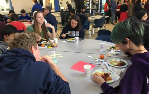 Student who take a Chinese language class celebrate Chinese New Year by learning about the culture and enjoying a meal.