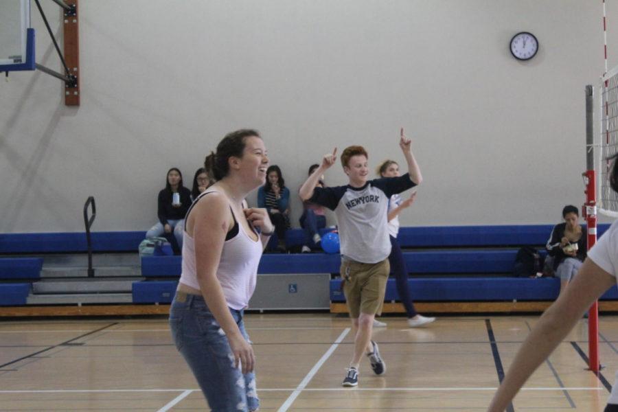 Brock Lotti and Chloe Kelly, two seniors, cheer on their teammates.