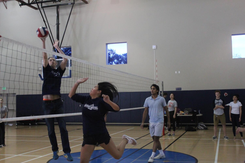 Science+teacher+Josh+Engburg+sets+the+ball+over+the+net.