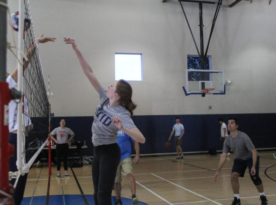 Physics teacher Veronica Heintz blocks the ball from crossing the net.