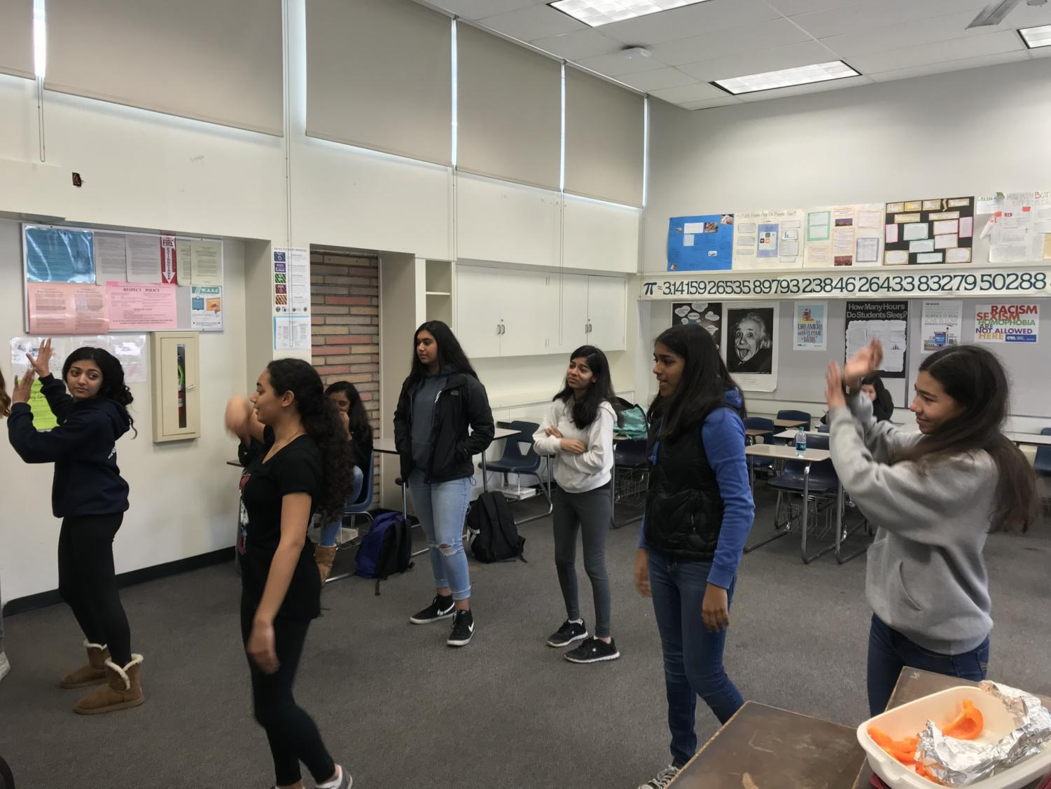 Club members practice a dance for the upcoming Heritage Fair