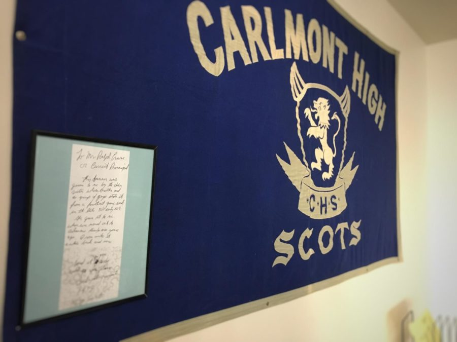 The Carlmont banner from the late 50s/early 60s now hangs in the administration office for all to see. The accompanying note is framed and rests on top of the banner.