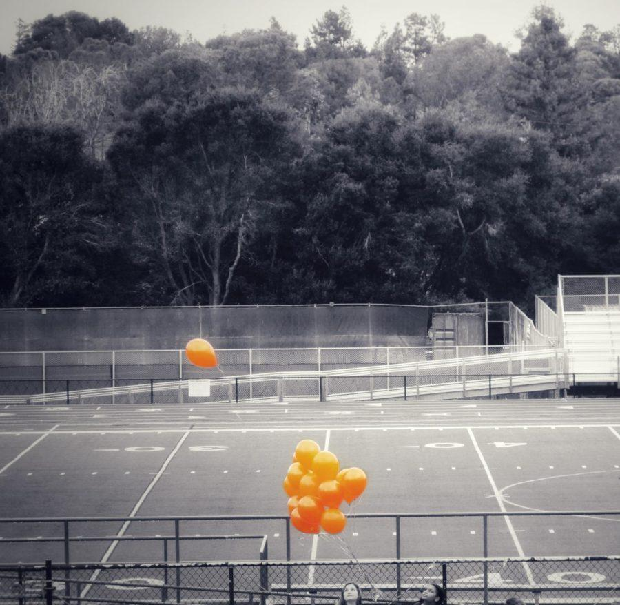 One by one, all 17 balloons were released. Untied with each passing minute, they honored the 17 lives lost.