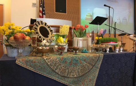 A colorful table was laid out at the San Mateo Library celebration of Nowruz.