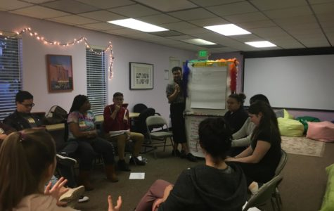 The prom committee members discuss the possible themes for this year's Queer Prom.