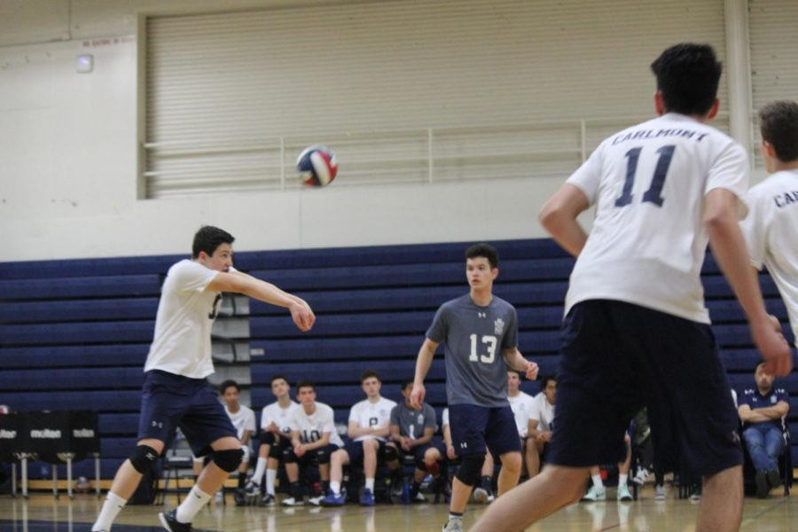 Hitter Max Jung receives a ball from a serve.