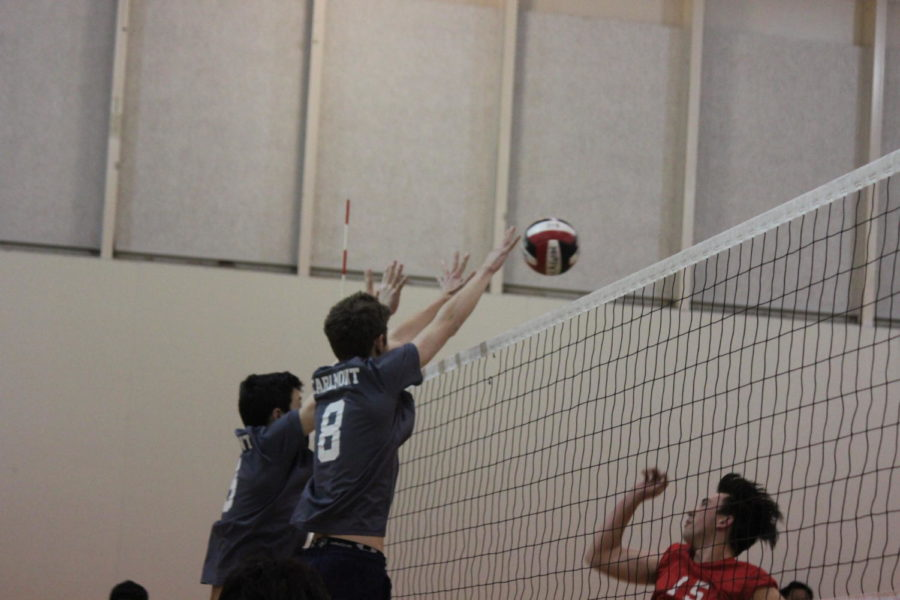 Junior Max Jung and Jimmy Rudger, a senior, go up to block an Aragon player's hit.
