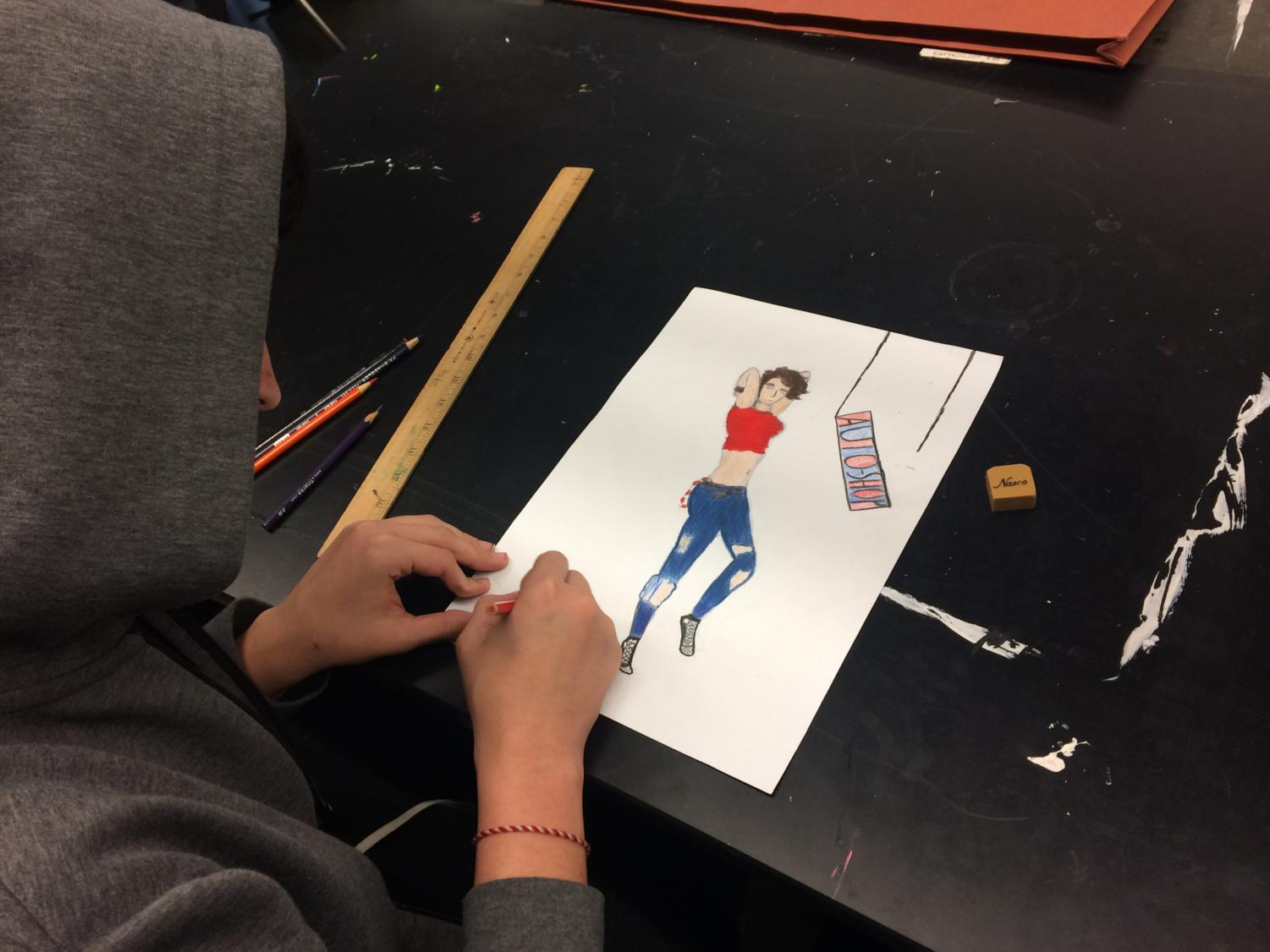 Nick Mattas works on his drawing inside of Art Club.