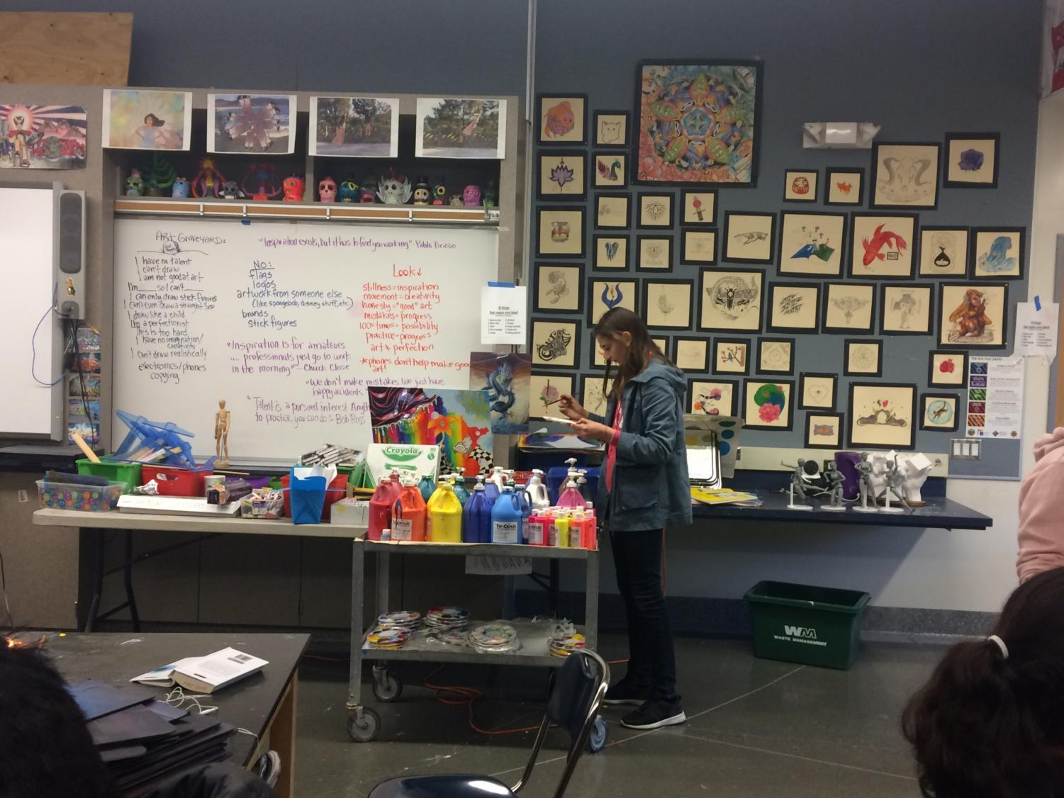 Holly+Bazigian+restocks+her+paint+supply+in+order+to+create+her+candle.